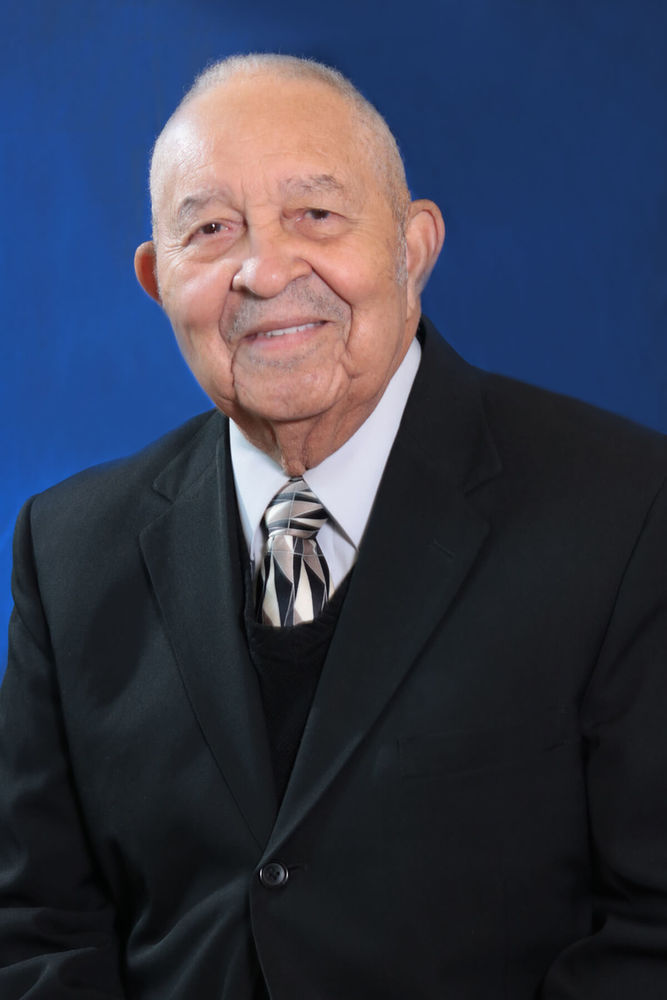 Rev. Louie B. George - Board Commissioner